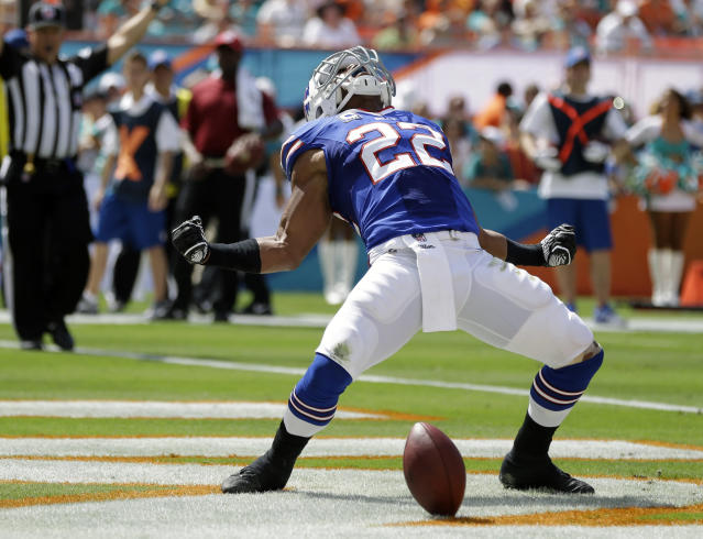 Buffalo Bills running back Fred Jackson (22) celebrates a touchdown during the first half of an NFL football game against the Miami Dolphins, Sunday, Oct. 20, 2013, in Miami Gardens, Fla. (AP Photo/Lynne Sladky)