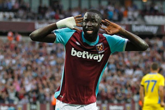 West Ham United's midfielder Cheikhou Kouyate celebrates after scoring his second goal during the qualifying third round second leg Europa League football match between West Ham United and NK Domzale in east London on August 4, 2016 (AFP Photo/Ian Kington)