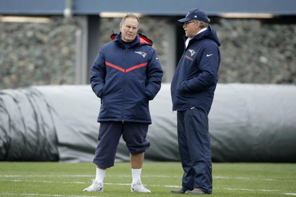 FILE — New England Patriots head coach Bill Belichick, left, speaks with football research director Ernie Adams, right, during an NFL football team practice, in this Wednesday, Dec. 7, 2016 file photo, in Foxborough, Mass. Adams, a former high school classmate of Belichick, participated in his final practice with the team Wednesday, June 16, 2021. Adams retired from his job at the Patriots, Wednesday, June 16, after 21 years with the team. (AP Photo/Steven Senne, File)