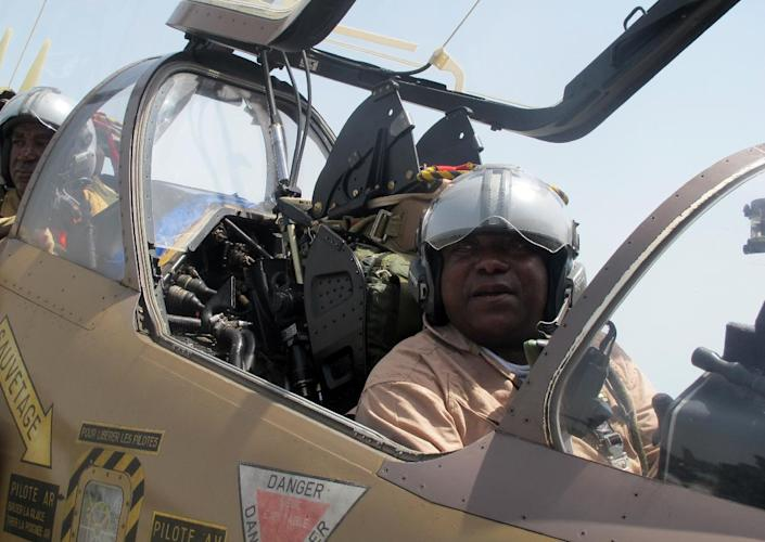 A Cameroonian Air Force pilot in sitting in an Alpha Jet after returning from a surveillance flight to monitor Nigerian Islamist group Boko Haram, on June 18, 2014 in Garoua, northern Cameroon (AFP Photo/Reinnier Kaze)