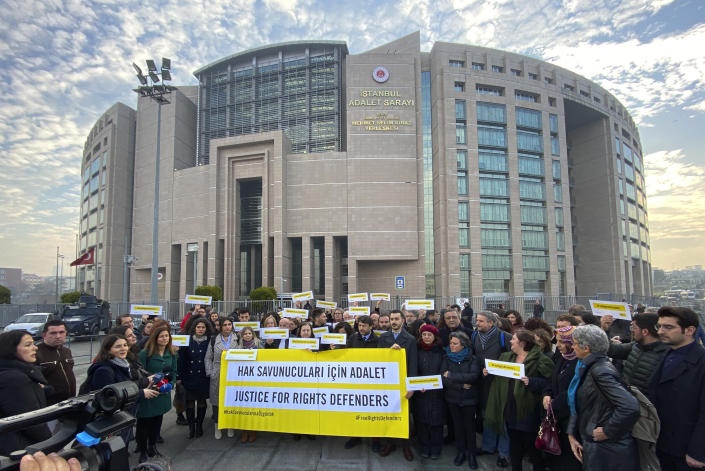 Turkish and international human rights activists speak to the media before the trial of the Amnesty International's former Turkey chairman and 10 other activists, in Istanbul, Wednesday, Feb. 19. 2020. A court in Istanbul will hand down verdicts for defendants in the closely-watched trial on charges of belonging to or aiding terror groups. The case against activists heightened concerns about Turkey's treatment of human rights defenders. (AP Photo)