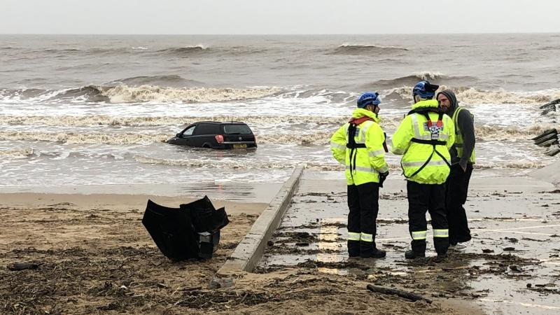Cars submerged amid flooding as UK deals with fallout from Storm Brendan