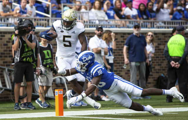 Georgia Tech's Jerry Howard Jr. (5) carries the ball past Duke's Marquis Waters (10) for a touchdown during an NCAA college football game in Durham, N.C., Saturday, Oct. 12, 2019. (AP Photo/Ben McKeown)