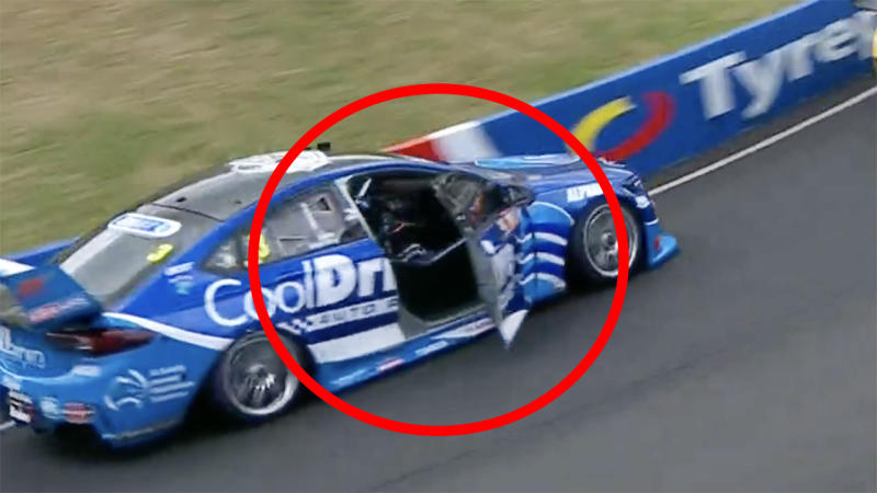 Macualey Jones is pictured driving with the door open on lap two of the Bathurst 1000.