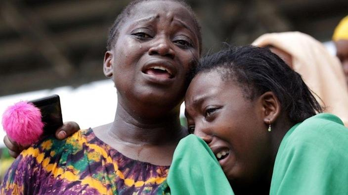 Civilians mourn late Tanzanian President John Pombe Magufuli during the state funeral at Uhuru stadium, the venue of the national requiem Mass in Dar es Salaam, Tanzania March 20, 2021