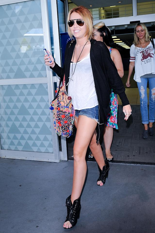 "<div class=""caption-credit""> Photo by: Getty Images</div><div class=""caption-title""></div>In August 2010, Miley Cyrus made her TSA pat-down seamless with revealing short-shorts and open-toed boots."