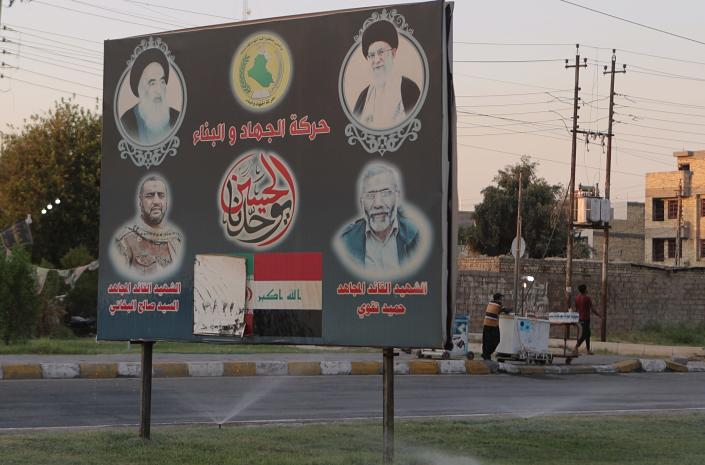 In this Wednesday, Sept. 18, 2019 photo, a billboard shows Iranian and Iraqi Shiite spiritual leaders, and volunteer fighters from the Iran-backed Popular Mobilization Forces who were killed in Iraq fighting Islamic State militants, in Baghdad, Iraq. As the U.S. and Israel step up their efforts to contain Iran, countries in Tehran's orbit are feeling the heat. Nowhere is that being felt more than in Iraq, where Shiite forces tied to Iran pose a growing challenge to the government's authority. (AP Photo/Khalid Mohammed)