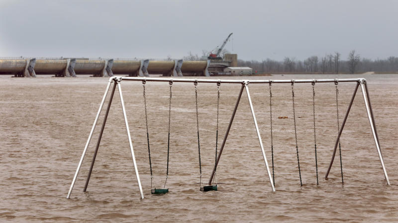 The playground in Clarksville Riverfront Park is flooded in downtown Clarksville, Mo., Saturday, March 30, 2019. The Mississippi River reached 32.8 feet Saturday afternoon, entering major flood stage for the first time this spring. It is expected to crest late Sunday at 34.2 feet, more than three feet below the 37.7 foot record of 1993. (Robert Cohen/St. Louis Post-Dispatch via AP)
