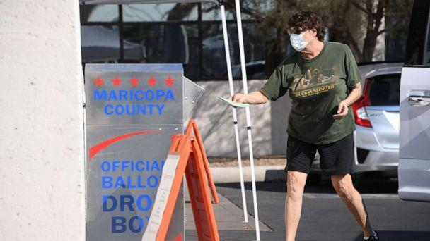 PHOTO: A voter deposits their mail-in ballot for the presidential election at a ballot collection box in Phoenix, Oct. 18, 2020. (Robyn Beck/AFP via Getty Images, FILE)