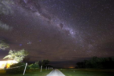 The Milky Way can be seen in the sky above a path and huts on Lady Elliot Island located 80 kilometers north-east from the town of Bundaberg in Queensland, Australia