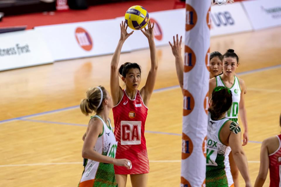 Singapore netball captain Charmaine Soh attempts a shot against Ireland at the Netball Nations Cup at OCBC Arena. (PHOTO: Netball Singapore)