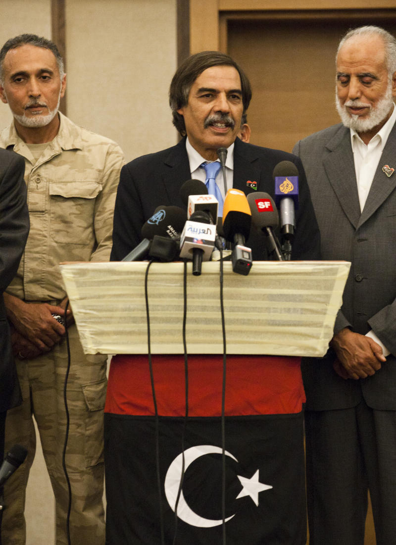 Ali Tarhouni, finance minister in the rebels' National Transitional Council,   speaks during a news conference in Tripoli, LIbya, Thursday, Aug. 25, 2011.  Ali Tarhouni, a member of Libya's rebel Cabinet says it is moving immediately to Tripoli from its eastern stronghold city of Benghazi, as opponents of Moammar Gadhafi solidify their control over the capital they overran four days ago.  (AP Photo/Giulio Petrocco)