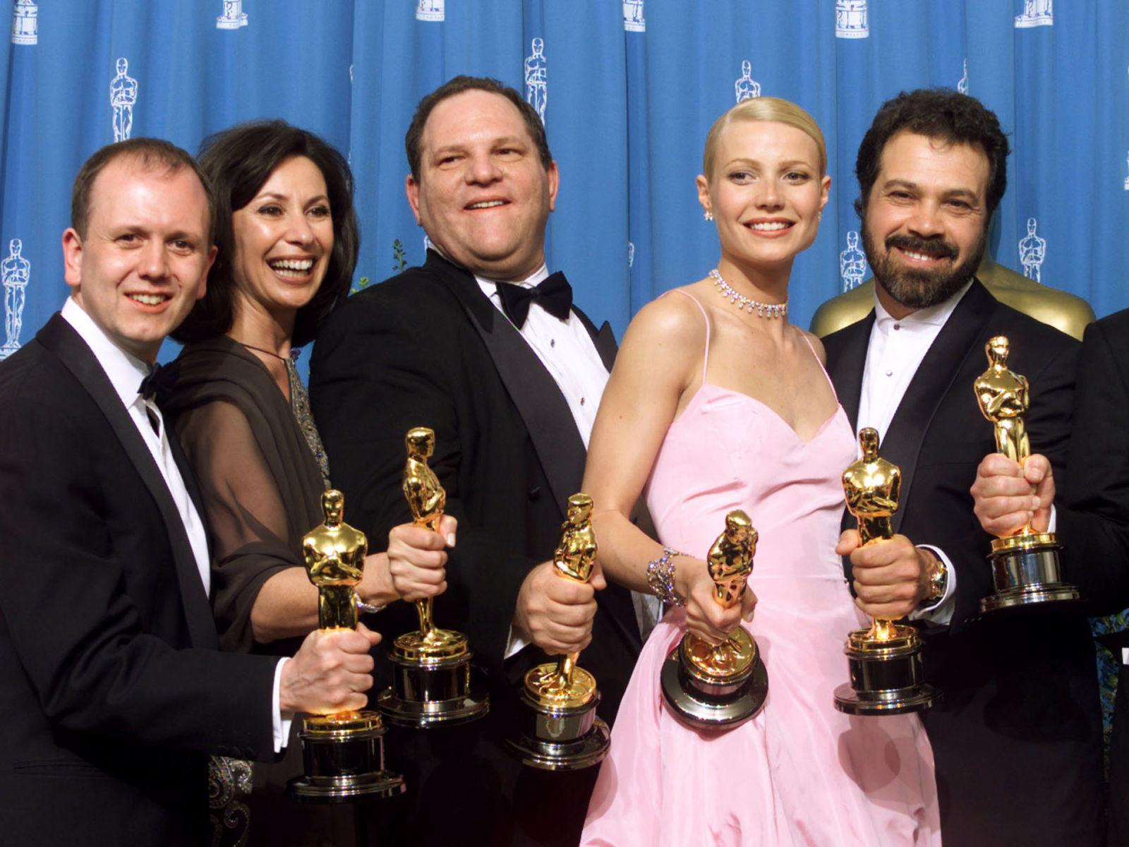 Paltrow celebrates with Shakespeare In Love producers, including Weinstein (3rd left)