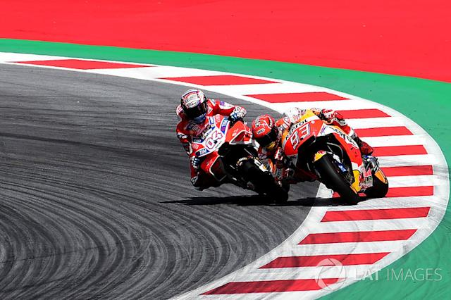 "Andrea Dovizioso, Ducati Team, Marc Marquez, Repsol Honda Team <span class=""copyright"">Gold and Goose / LAT Images</span>"