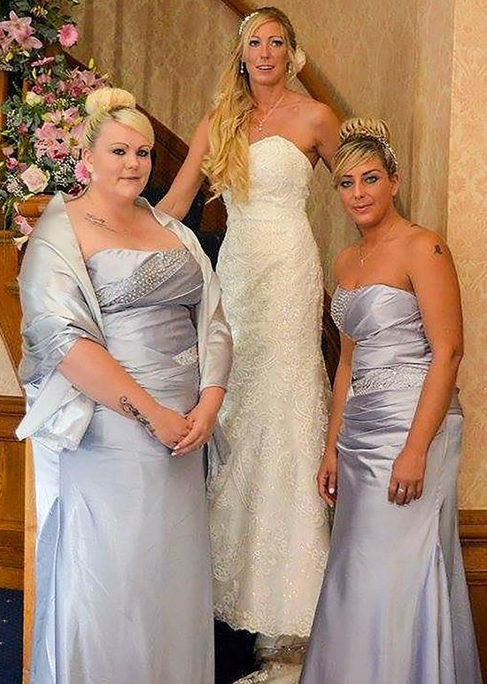 Katie was a size 24 at her heaviest and said the turning point was when this bridesmaid dress for her sister's wedding had to be made for her. Photo: Caters News