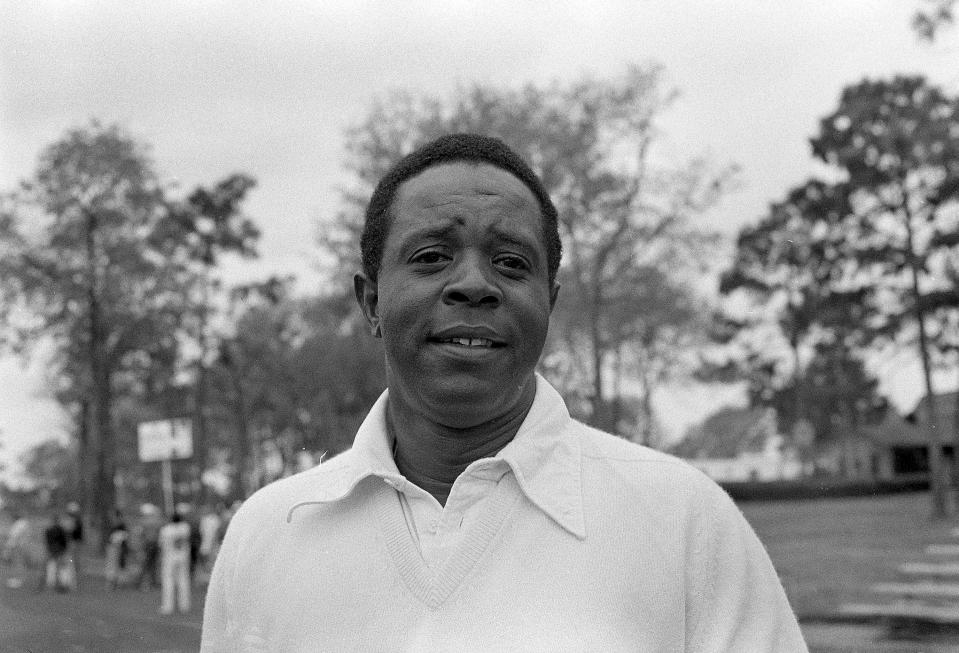 FILER - This is a 1974 file photo showing golfer Lee Elder. Lee Elder was already 40 years old when he made history as the first Black player to tee off at the Masters, so many of his prime years squandered by the scourge of racism. (AP Photo/File)