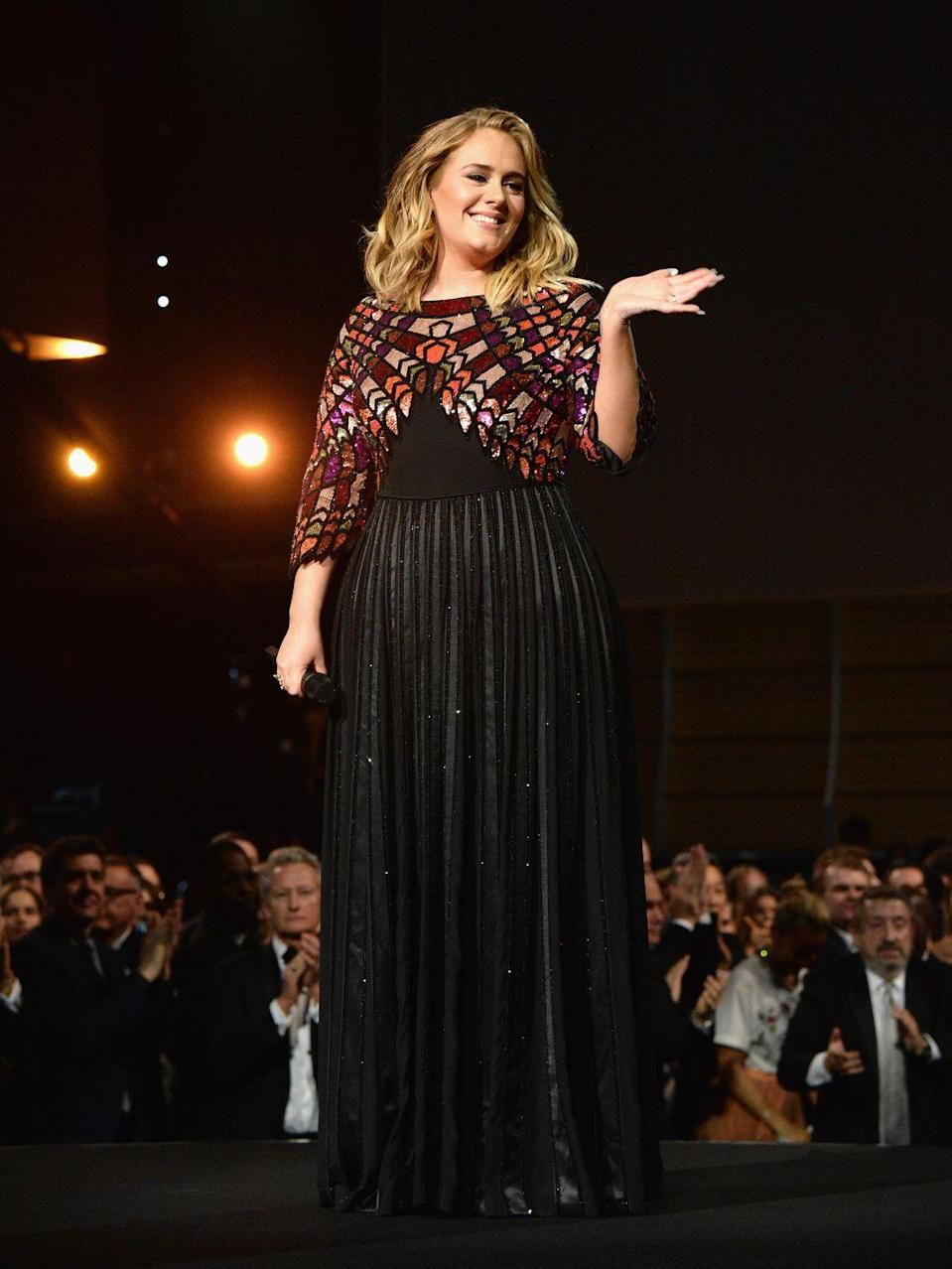 <p>She then appeared on stage in her second Givenchy look, which featured a brightly coloured bodice and pleated skirt. </p>