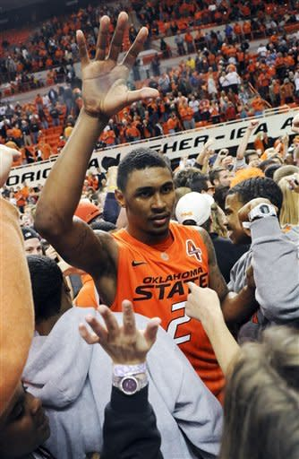 Oklahoma State guard Le'Bryan Nash celebrates with fans following a 27-point performance in Oklahoma State's 79-72 win over Missouri in an NCAA college basketball game in Stillwater, Okla., Wednesday, Jan. 25, 2012. (AP Photo/Brody Schmidt)