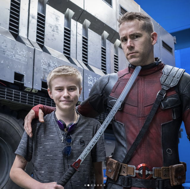 "<p>""One of the best parts of playing the Big Red Jackass is welcoming @makeawishamerica and @childrenswishfoundation onto set,"" the kind-hearted actor captioned a series of shots with the kids. ""Deadpool kicked Cancer in the taint, but these kids do it for real every day. These foundations make dreams come true for a lot of of super-brave kids. They also make dreams come true for parents, who just wanna see their kid smile,"" he continued. ""HUGE thanks to our Prop Master, Dan Sissons, for making sure every kid left with his/her own sword. (Bamboo versions. Not stabby-stabby versions.)"" (Photo: <a href=""https://www.instagram.com/p/BfYdMUnD9tG/?taken-by=vancityreynolds"" rel=""nofollow noopener"" target=""_blank"" data-ylk=""slk:Ryan Reynolds via Instagram"" class=""link rapid-noclick-resp"">Ryan Reynolds via Instagram</a>) </p>"
