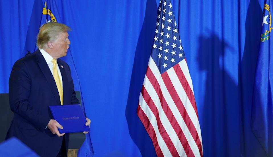 A graduate walks up to receive his diploma from U.S. President Donald Trump at the Hope for Prisoners Graduation Ceremony attended in Las Vegas, Nevada, February 20, 2020. (Photo: REUTERS/ Kevin Lamarque)