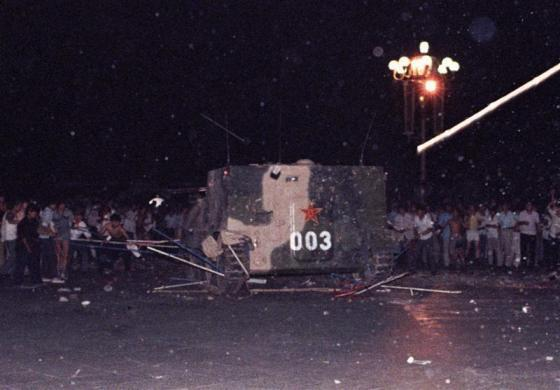 An armored military vehicle crushes one of the tents set up on Tiananmen Square by pro-democracy protestors, June 4, 1989.