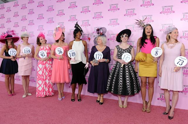 IMAGE DISTRIBUTED FOR LONGINES - Criselda Breene, second right, of Miami Beach, Fl., reacts after winning the Longines Kentucky Oaks Fashion Contest, and a Longines timepiece, on Kentucky Oaks Day, Friday, May 2, 2014, in Louisville, Ky. Longines, the Swiss watch manufacturer known for its luxury timepieces, is the Official Watch and Timekeeper of the 140th annual Kentucky Derby. (Photo by Diane Bondareff/Invision for Longines/AP Images)
