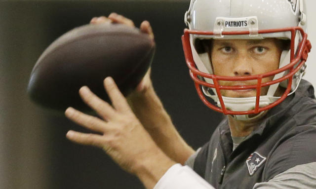 New England Patriots quarterback Tom Brady (12) looks for a receiver during NFL football minicamp at the team's indoor training facility Tuesday, June 19, 2014 in Foxborough, Mass. (AP Photo Stephan Savoia)