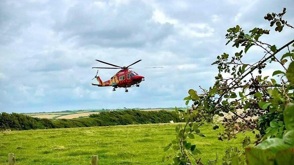 Cornwall Air Ambulance assisted in the rescue operations of the two individuals trapped under the boulders   (Cornwall Air Ambulance/ Twitter)