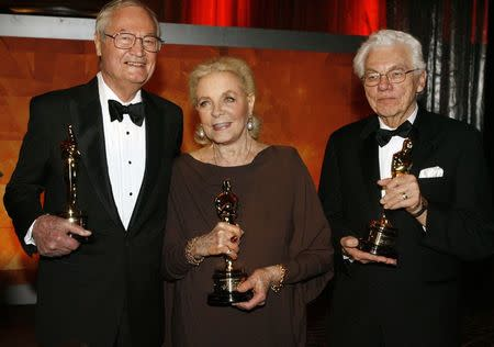 Actress Lauren Bacall (C), cinematographer Gordon Willis (R) and filmmaker Roger Corman pose with their Honorary Oscars at the Academy of Motion Picture Arts & Sciences 2009 Governors Awards in Hollywood, California in this file picture taken November 14, 2009. REUTERS/Fred Prouser/Files