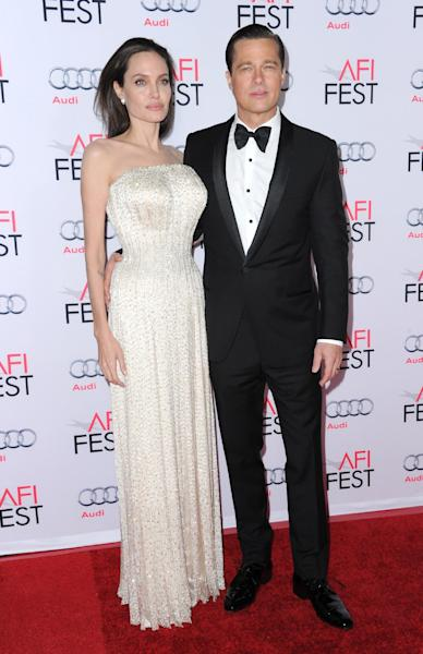 """FILE - In this Nov. 5, 2015 file photo, Angelina Jolie, left, and Brad Pitt arrive at the 2015 AFI Fest opening night premiere of """"By The Sea"""" in Los Angeles. Angelina Jolie Pitt has filed for divorce from Brad Pitt, bringing an end to one of the world's most star-studded, tabloid-generating romances. An attorney for Jolie Pitt, Robert Offer, said Tuesday, Sept. 20, 2016, that she has filed for the dissolution of the marriage. (Photo by Richard Shotwell/Invision/AP, File)"""