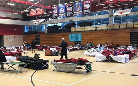 People seen in the hurricane shelter set up in the Belle Chasse High School gym in advance of Hurricane Nate in Belle Chasse, Louisiana, U.S. October 7, 2017.  REUTERS/Jessica Resnick-Ault