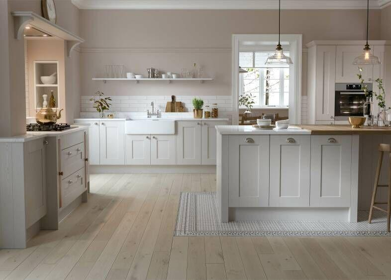 """<p>Where bold colours can make your white cabinets stand out, soft contrasts can have a calming effect in a white kitchen. This mix of pale wood floors, off-white shaker cabinets, and delicate blush walls is modern without being overly saccharine.</p><p>Pictured: <a href=""""https://www.wrenkitchens.com/kitchens/shaker-forest-shadow-grain/10514"""" rel=""""nofollow noopener"""" target=""""_blank"""" data-ylk=""""slk:Shaker Forest Kitchen in Shadow at Wren"""" class=""""link rapid-noclick-resp"""">Shaker Forest Kitchen in Shadow at Wren</a><strong><br><br>Follow House Beautiful on <a href=""""https://www.instagram.com/housebeautifuluk/"""" rel=""""nofollow noopener"""" target=""""_blank"""" data-ylk=""""slk:Instagram"""" class=""""link rapid-noclick-resp"""">Instagram</a>.</strong></p>"""
