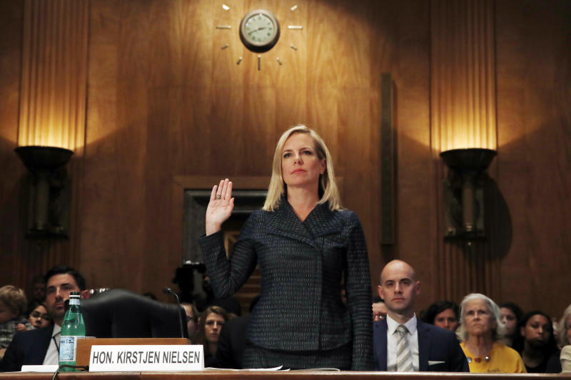 Homeland Security Secretary Kirstjen Nielsen is sworn in before testifying to the Senate Homeland Security Committee, Tuesday, May 15, 2018, on Capitol Hill in Washington. (AP Photo/Jacquelyn Martin)