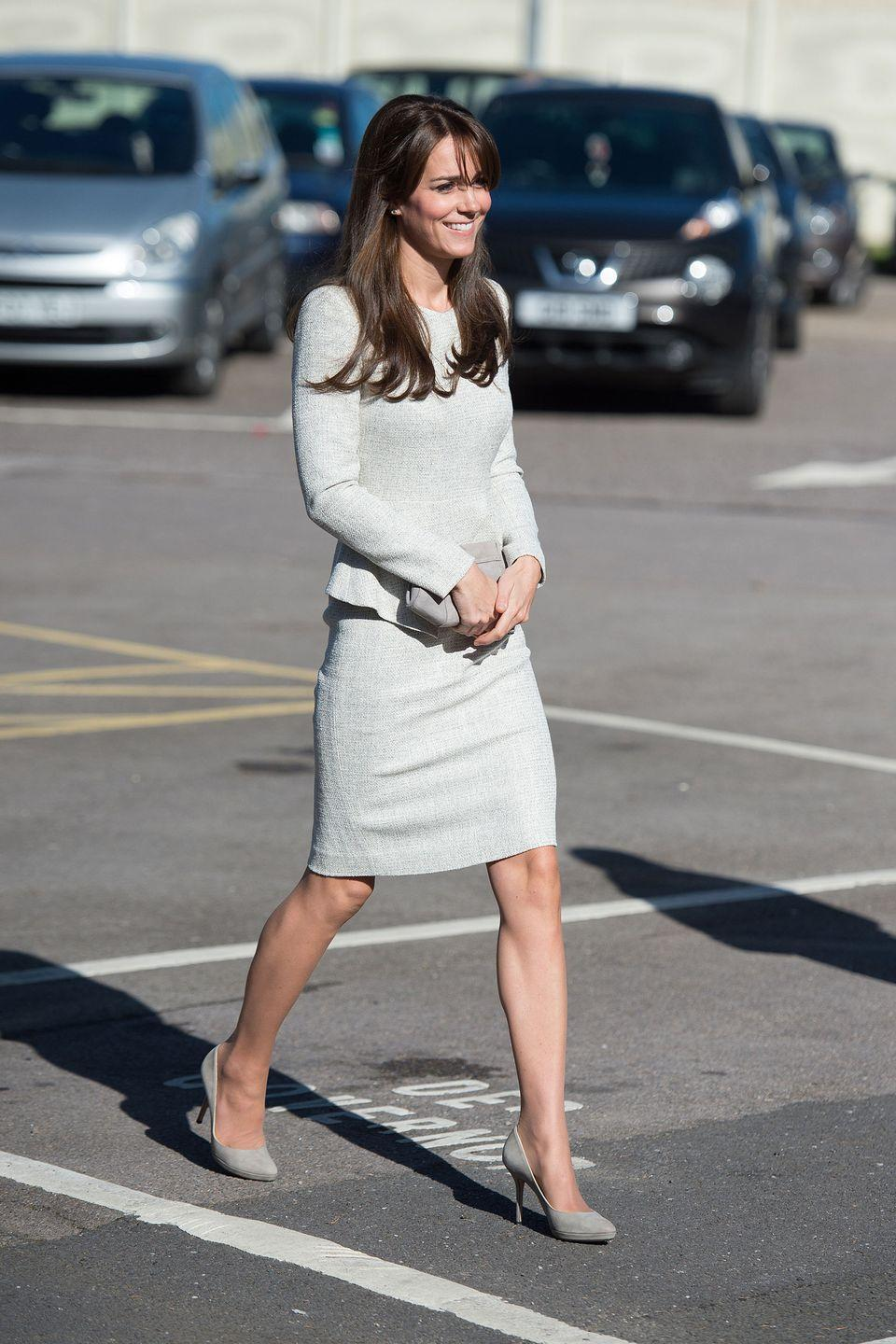 """<p>The Duchess pays a visit to the Rehabilitation of Addicted Prisoners Trust, a women's prison in Surrey, England, in a modest dress by <a href=""""https://thefoldlondon.com/product/eaton-dress-spring-white-tweed-ps15/"""" rel=""""nofollow noopener"""" target=""""_blank"""" data-ylk=""""slk:The Fold"""" class=""""link rapid-noclick-resp"""">The Fold</a>.</p>"""