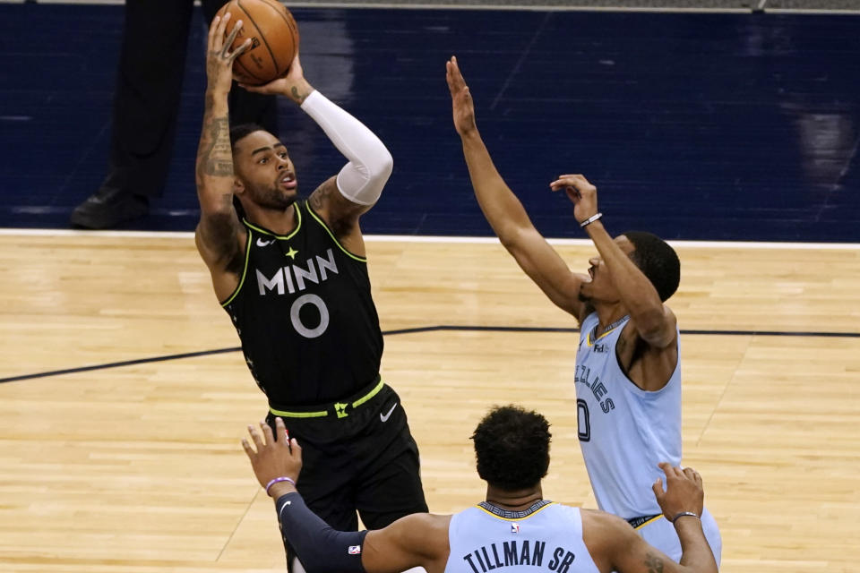 Minnesota Timberwolves' D'Angelo Russell (0) shoots as Memphis Grizzlies' De'Anthony Melton defends during the first half of an NBA basketball game Wednesday, May 5, 2021, in Minneapolis. (AP Photo/Jim Mone)
