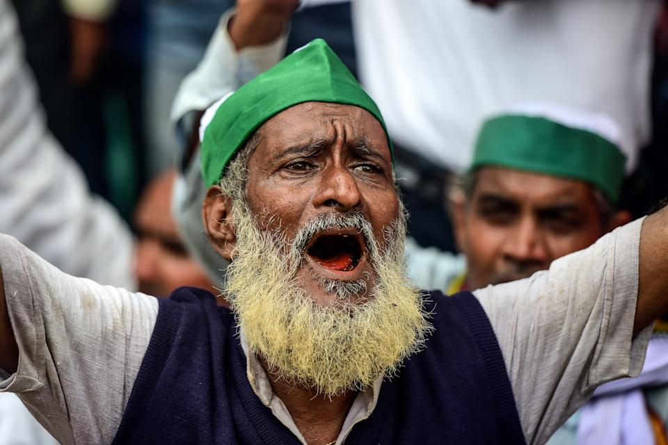 A farmer of the Bharatiya Kisan Union (BKU) - Indian Farmers' Union shouts slogans against Indian Prime Minister Narendra Modi's government during a nationwide farmers' strike following the recent passing of agriculture bills in the Lok Sabha (lower house), in Allahabad on September 25, 2020. (Photo by SANJAY KANOJIA/AFP via Getty Images)