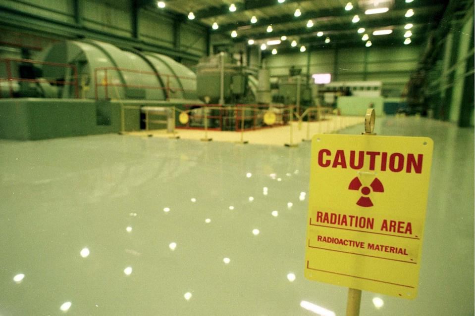 FILE - In this Dec. 1997 file photo, a sign warns of radioactive material at the Vermont Yankee nuclear power plant in Vernon, Vt. Vermont's only nuclear power plant will shut down by the end of 2014, ending a nasty legal battle over the future of the 4-decade-old plant, Entergy Corp. announced Tuesday, Aug. 27, 2013. The Vermont Yankee Nuclear Power Station is expected to cease power production after its current fuel cycle and will begin being decommissioned in the fourth quarter of 2014, the company said. (AP Photo/Toby Talbot, File)