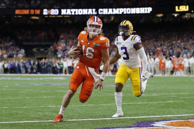 Clemson quarterback Trevor Lawrence scores past LSU safety JaCoby Stevens during the first half of a NCAA College Football Playoff national championship game Monday, Jan. 13, 2020, in New Orleans. (AP Photo/Gerald Herbert)