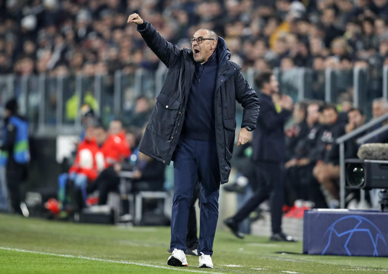 Juventus' head coach Maurizio Sarri reacts during the Champions League group D soccer match between Juventus and Atletico Madrid at the Allianz stadium in Turin, Italy, Tuesday, Nov. 26, 2019. (AP Photo/Antonio Calanni)