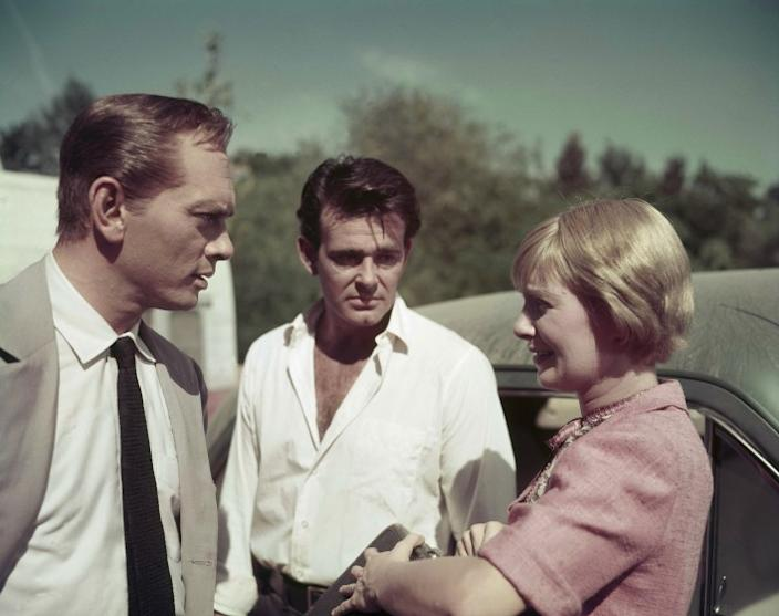 """Actors Yul Brynner, left, Stuart Whitman and Joanne Woodward, on the set of """"The Sound and the Fury"""" in Louisiana on Dec. 18, 1958. <span class=""""copyright"""">(Associated Press)</span>"""