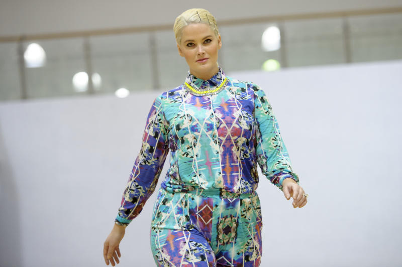 CORRECTING IDENTITY OF MODEL TO WHITNEY THOMPSON - Model Whitney Thompson wears a design during the Plus Size Fashion event during London Fashion Week Autumn/Winter 2014, at Vinopolis in central London, Friday, Feb. 14, 2014. (Photo by Jonathan Short/Invision/AP)