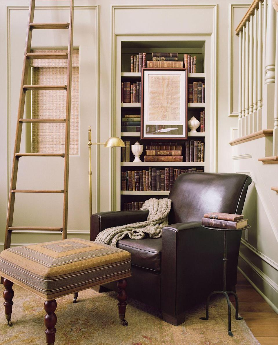 <p>A traditional library setup — complete with an upholstered leather chair and built-in bookshelves — is a no-fail option for reading.</p>