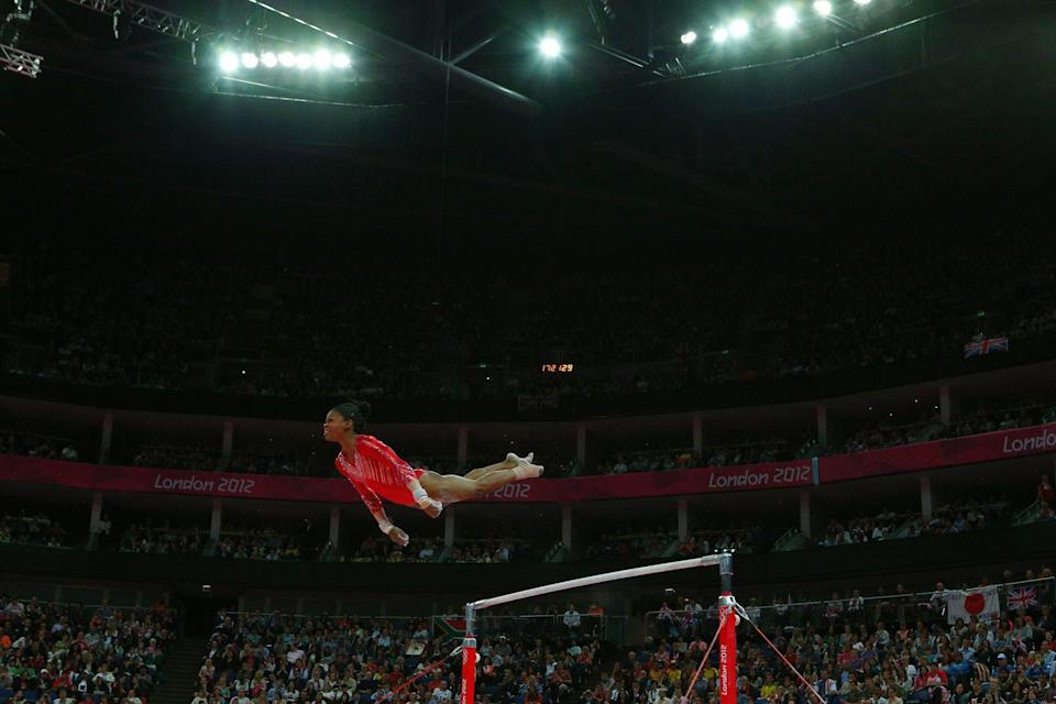 <p>Gabby Douglas earned her all-around title at the London games and soared to new heights, becoming the first woman of color to earn that title. </p>