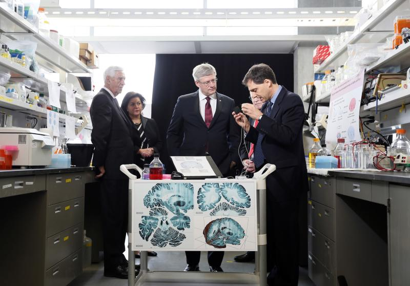 Canadian Prime Minister Stephen Harper tours a research lab in Montreal