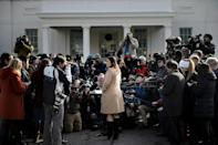Press Secretary Sarah Sanders speaks to reporters outside the White House shortly after President Donald Trump met a North Korean general, Kim Yong Chol