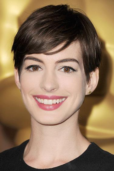 "<div class=""caption-credit""> Photo by: Steve Granitz/WireImage</div><div class=""caption-title"">Anne Hathaway</div><b>The Cut:</b> The Oscar-winner's hairstylist <a rel=""nofollow"" target="""" href=""https://www.facebook.com/AdirAbergel?link=emb&dom=yah_life&src=syn&con=blog_blog_hbz&mag=har%20"">Adir Abergel</a> describes this cut as a modern pixie with tomboy swagger. ""It has a long, sideswept bang and the back is short and heavily layered for a soft, feminine line,"" he says. <br> <b>What You Should Know:</b> ""Short hair looks great on anyone with dramatic features,"" says Abergel. He also puts to bed the myth that a closely shorn style is one-note. ""Slick it with gel and part on the side for a sleek, wet look. Or let it air dry and add texture with pomade for a messier vibe,"" he adds. <br> <b><br> Read More: <br> <a rel=""nofollow"" target="""" href=""http://www.harpersbazaar.com/beauty/health-wellness-articles/skincare-tools-0311?link=emb&dom=yah_life&src=syn&con=blog_blog_hbz&mag=har"">Skin Gadgets That Actually Work</a></b> <br> <b><a rel=""nofollow"" target="""" href=""http://www.harpersbazaar.com/beauty/health-wellness-articles/fitness-diaries-get-fit-fast-0612?link=emb&dom=yah_life&src=syn&con=blog_blog_hbz&mag=har"">Steps to Get Fit in Four Weeks</a></b> <br>"
