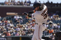 San Francisco Giants' Brandon Crawford hits a three-run home run against the San Diego Padres during the second inning of a baseball game in San Francisco, Saturday, May 8, 2021. (AP Photo/Jeff Chiu)