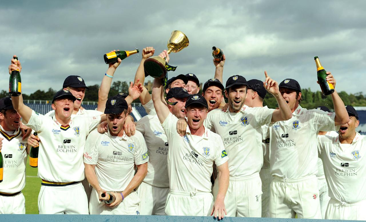 Durham captain Paul Collingwood lifts the trophy after winning the LV= County Championship Division One at the Emirates Durham ICG, Chester-Le-Street.