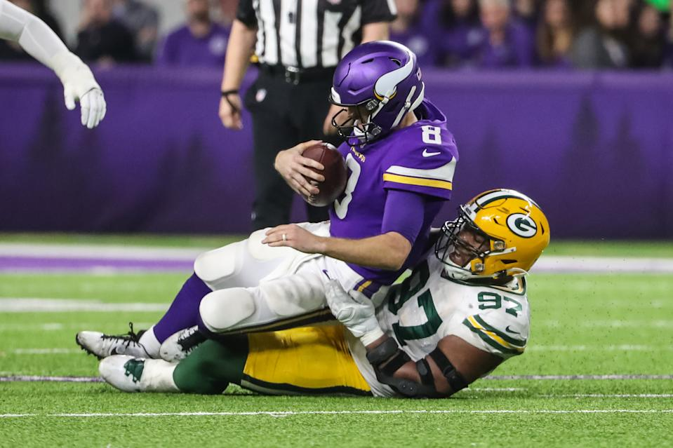Dec 23, 2019; Minneapolis, Minnesota, USA; Minnesota Vikings quarterback Kirk Cousins (8) is sacked by Green Bay Packers defensive tackle Kenny Clark (97) during the fourth quarter at U.S. Bank Stadium. Mandatory Credit: Brace Hemmelgarn-USA TODAY Sports