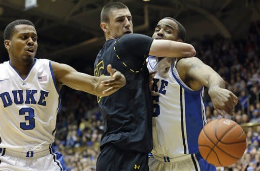 Duke's Tyler Thornton (3) and Josh Hairston, right, struggle for a rebound with Maryland's Alex Len during the first half of an NCAA college basketball game in Durham, N.C., Saturday, Jan. 26, 2013. (AP Photo/Gerry Broome)